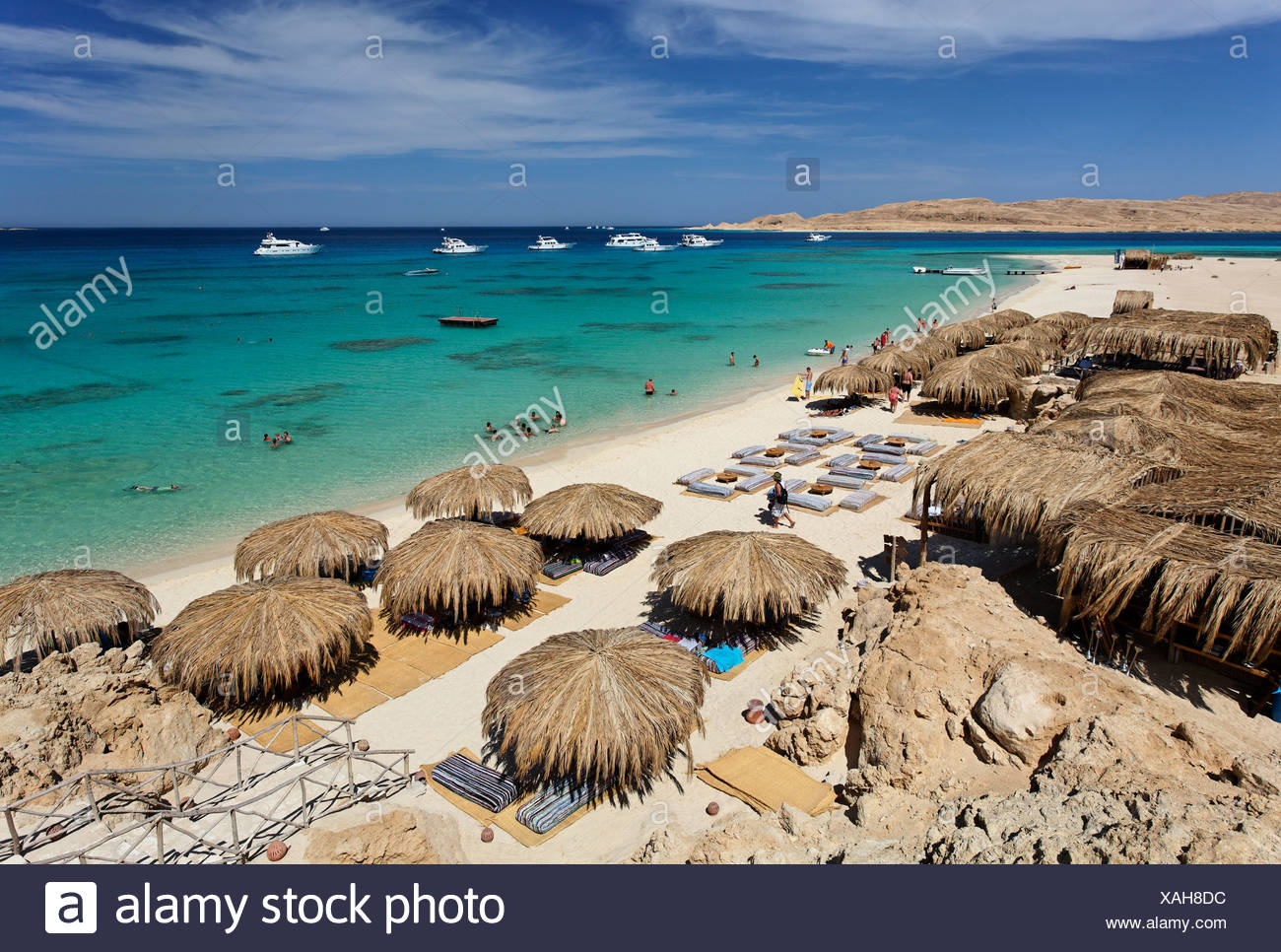 Beach, parasols, lagoon, swimmers, people, ships, Beach Mahmya, beach, Giftun Island, Hurghada, Egypt, Africa, Red Sea - Stock Image