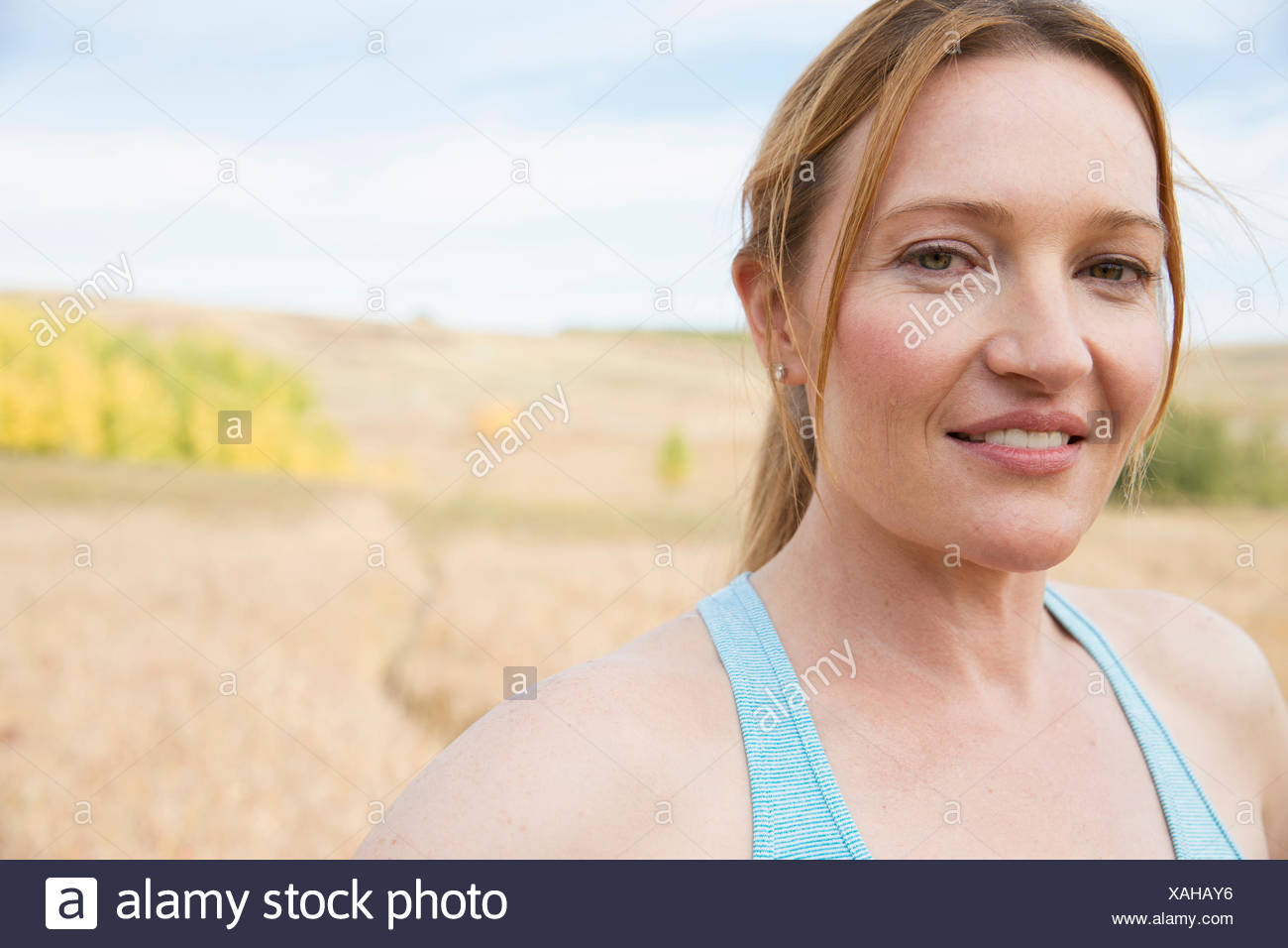 Pretty redhead looking serious after outdoor workout. - Stock Image
