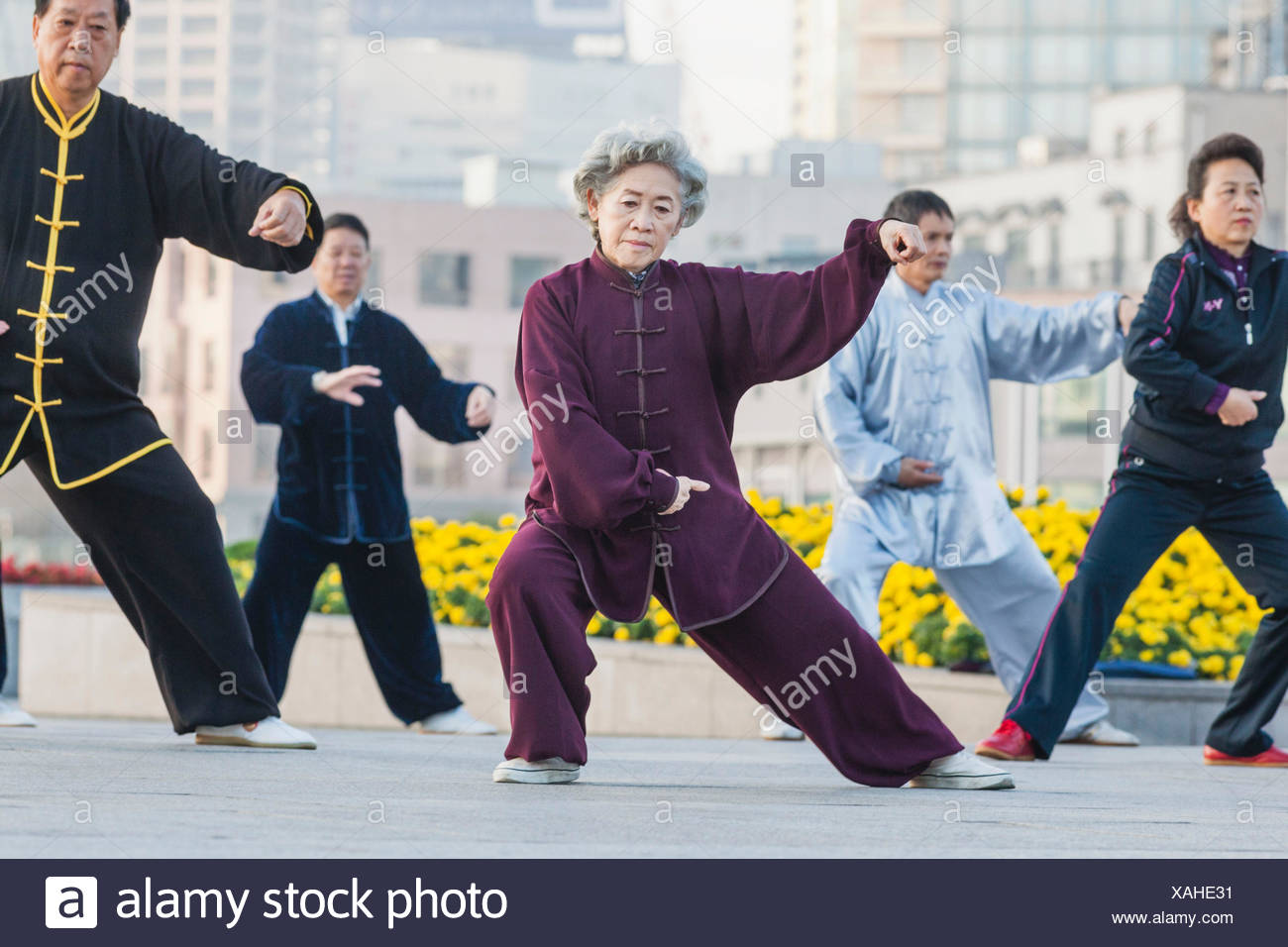 China, Shanghai, The Bund, Elderly Couple Practicing Tai chi - Stock Image