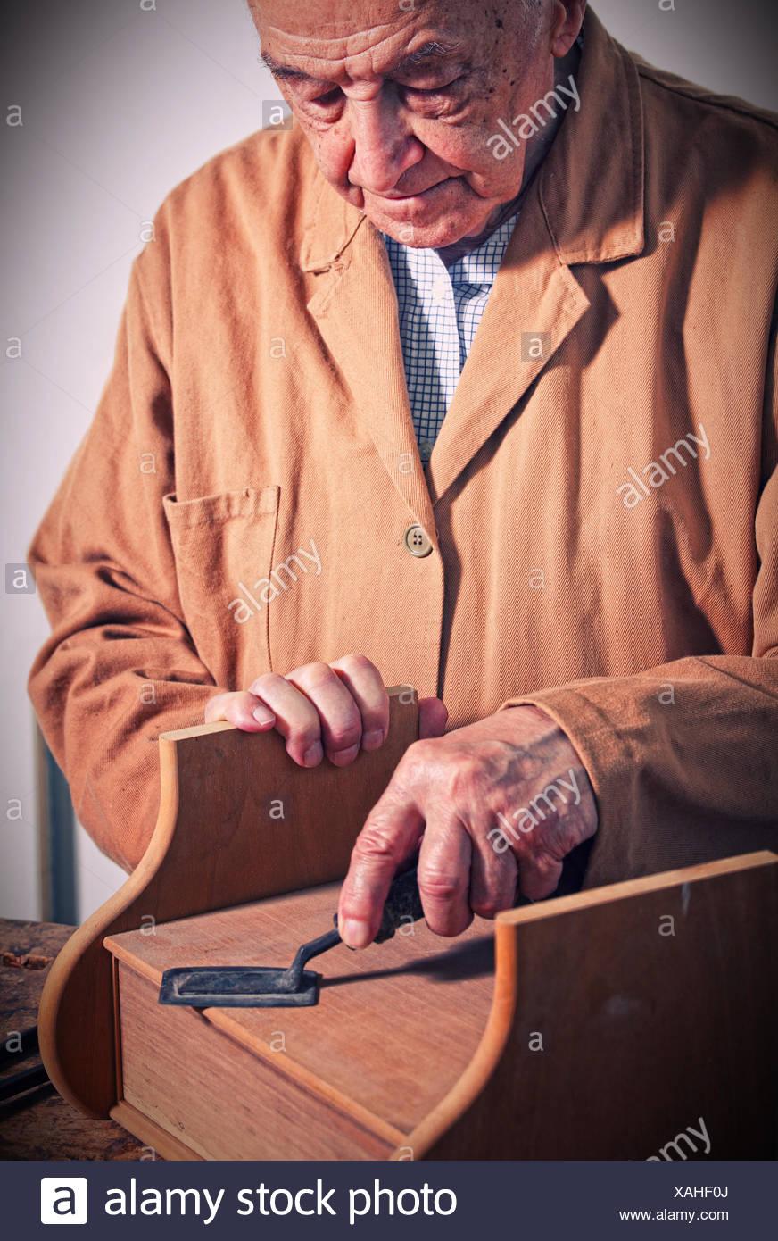 senior carpenter - Stock Image