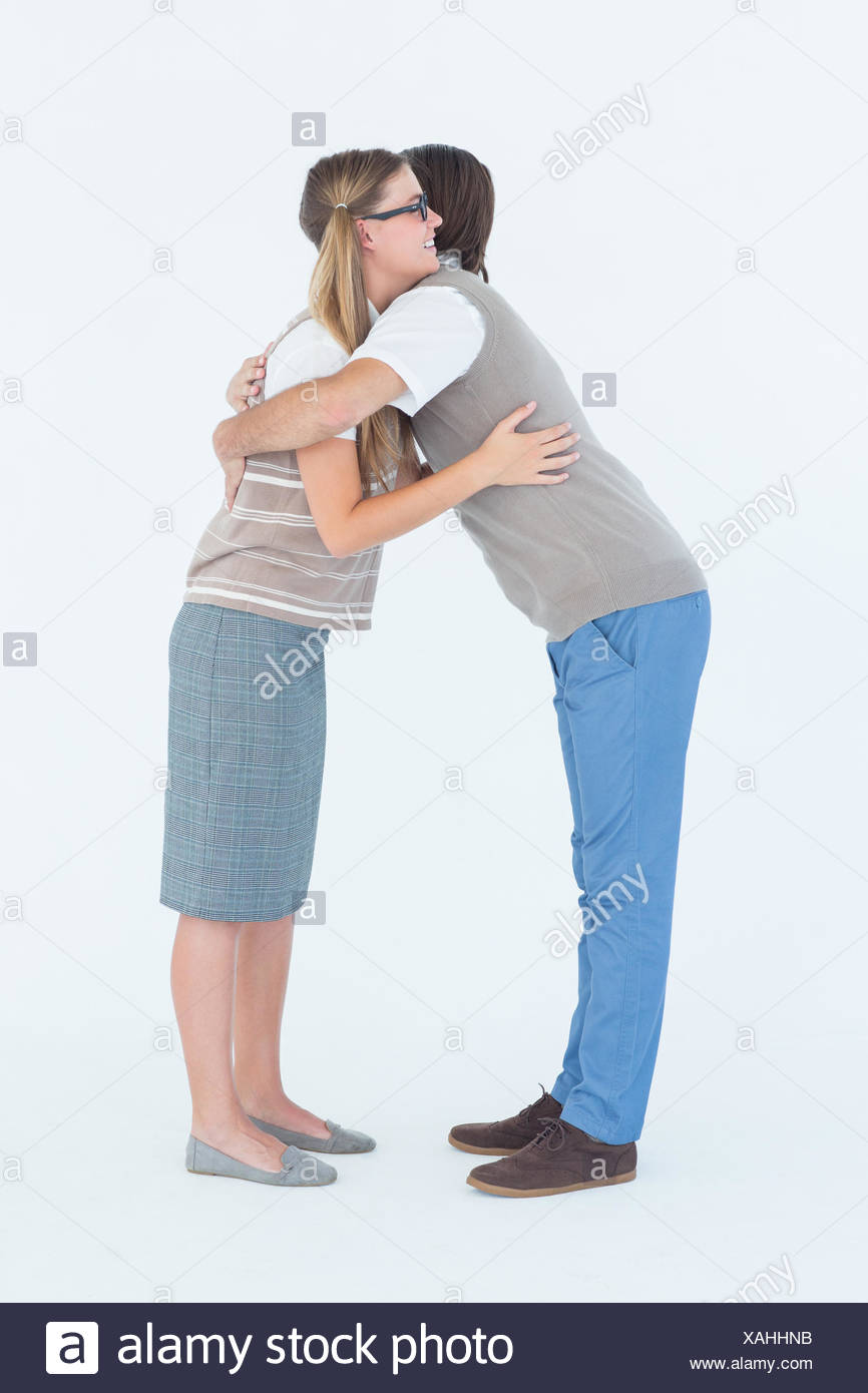 Geeky hipster couple hugging - Stock Image