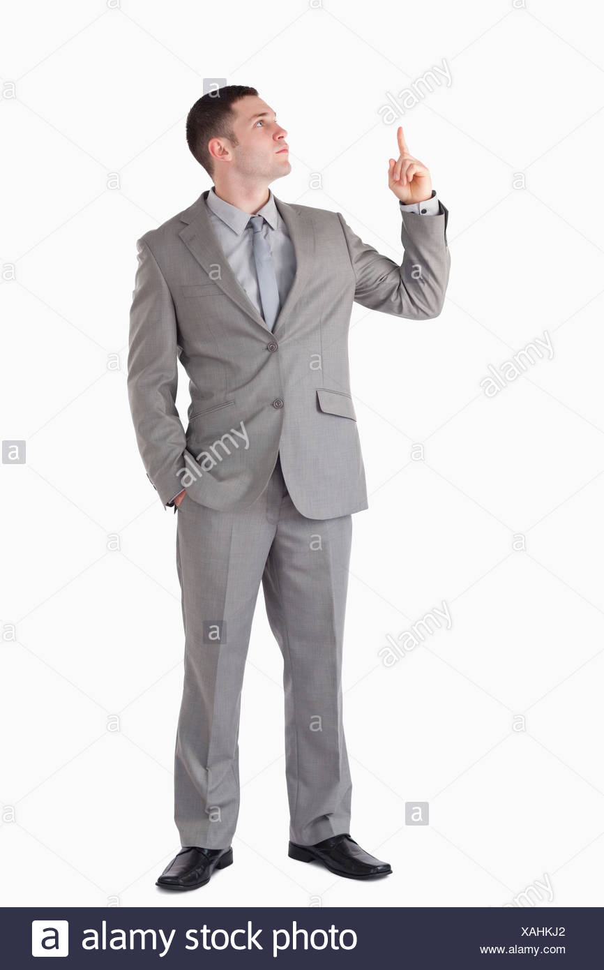 Portrait of a businessman pointing at a blank space - Stock Image
