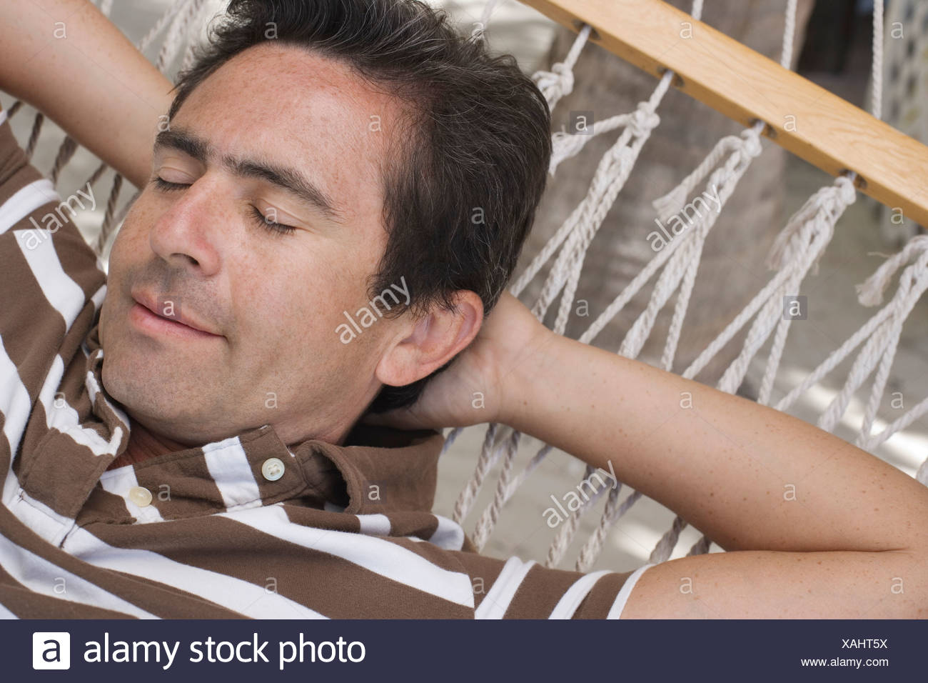 Man relaxing in hammock Stock Photo