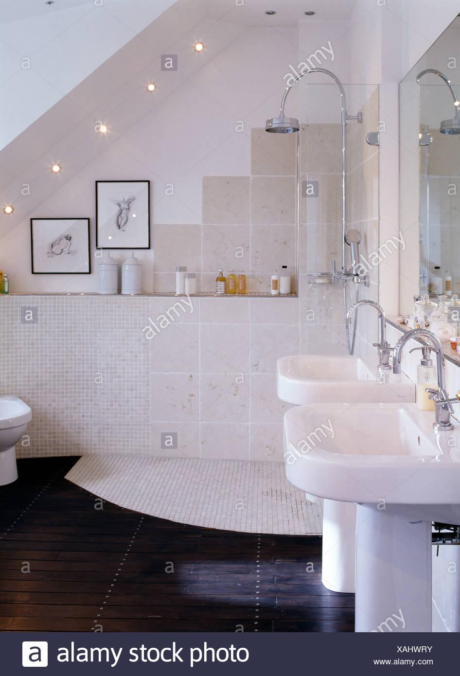 Two pedestal washbasins in modern white attic bathroom with chrome ...