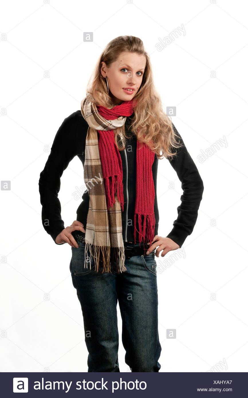 Young woman, 24 years old, with two scarves and wool jumper - Stock Image
