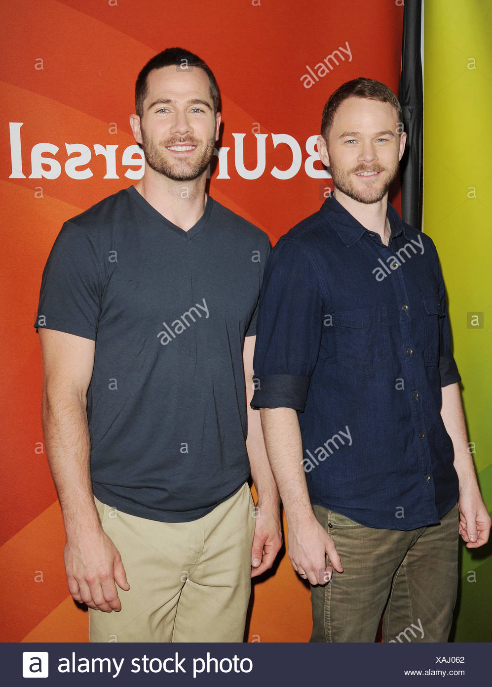 Actors Aaron Ashmore (L) and Luke MacFarlane attend the 2015 NBCUniversal Summer Press Day held at the The Langham Huntington Hotel and Spa on April 02, 2015 in Pasadena, California., Additional-Rights-Clearances-NA - Stock Image
