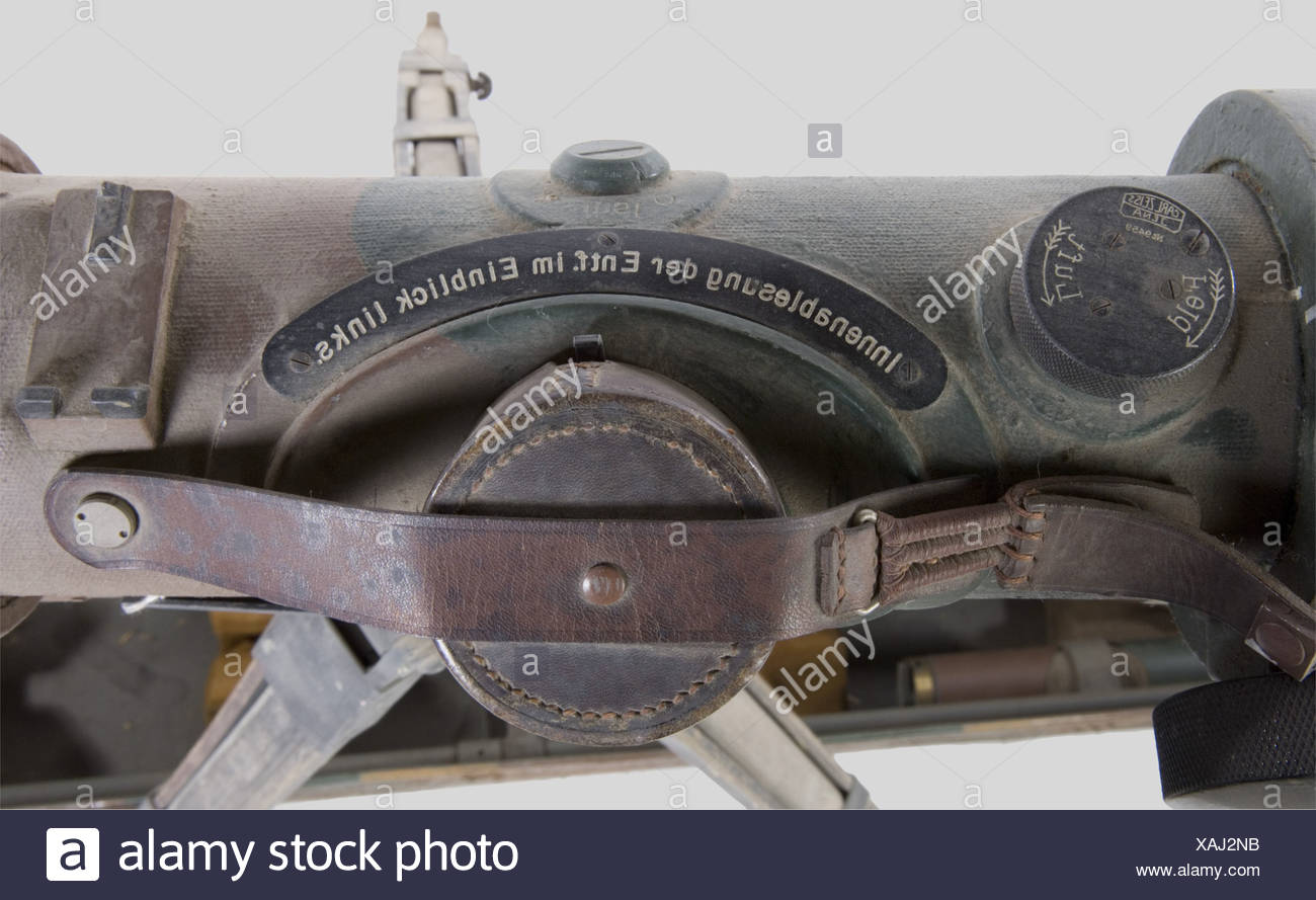 A Zeiss rangefinder of the Heer., Metal with three tones camouflage paint, complete with its covers and leather strap. Wooden tripod. Camouflaged metallic carrier box (corroded paint) with all accessories, notably the pegs, sun deflectors and gauge. Length 1,25 m., historic, historical, 1930s, 1930s, 20th century, technical, technic, material, materials, device, devices, equipment, equipments, utensil, piece of equipment, utensils, technology, militaria, military, object, objects, stills, clipping, clippings, cut out, cut-out, cut-outs, Additional-Rights-Clearances-NA - Stock Image