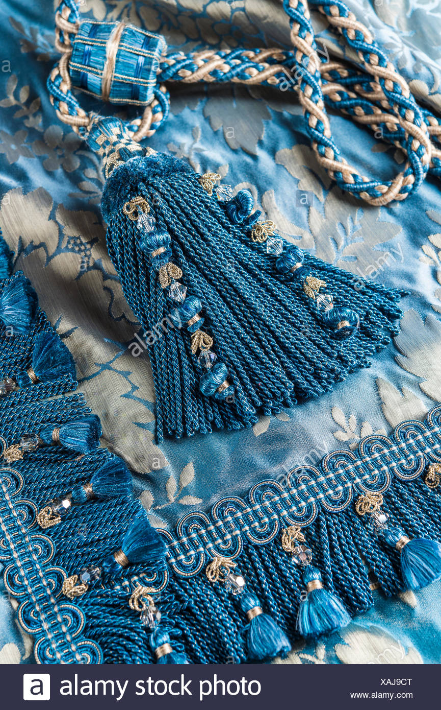 Passementerie, blue and silver cord tassel, with matching cord and connecting piece for curtain tie-back and woven border or - Stock Image