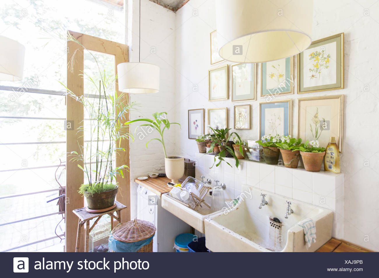 Wall Hangings And Lights Over Rustic Kitchen Sink