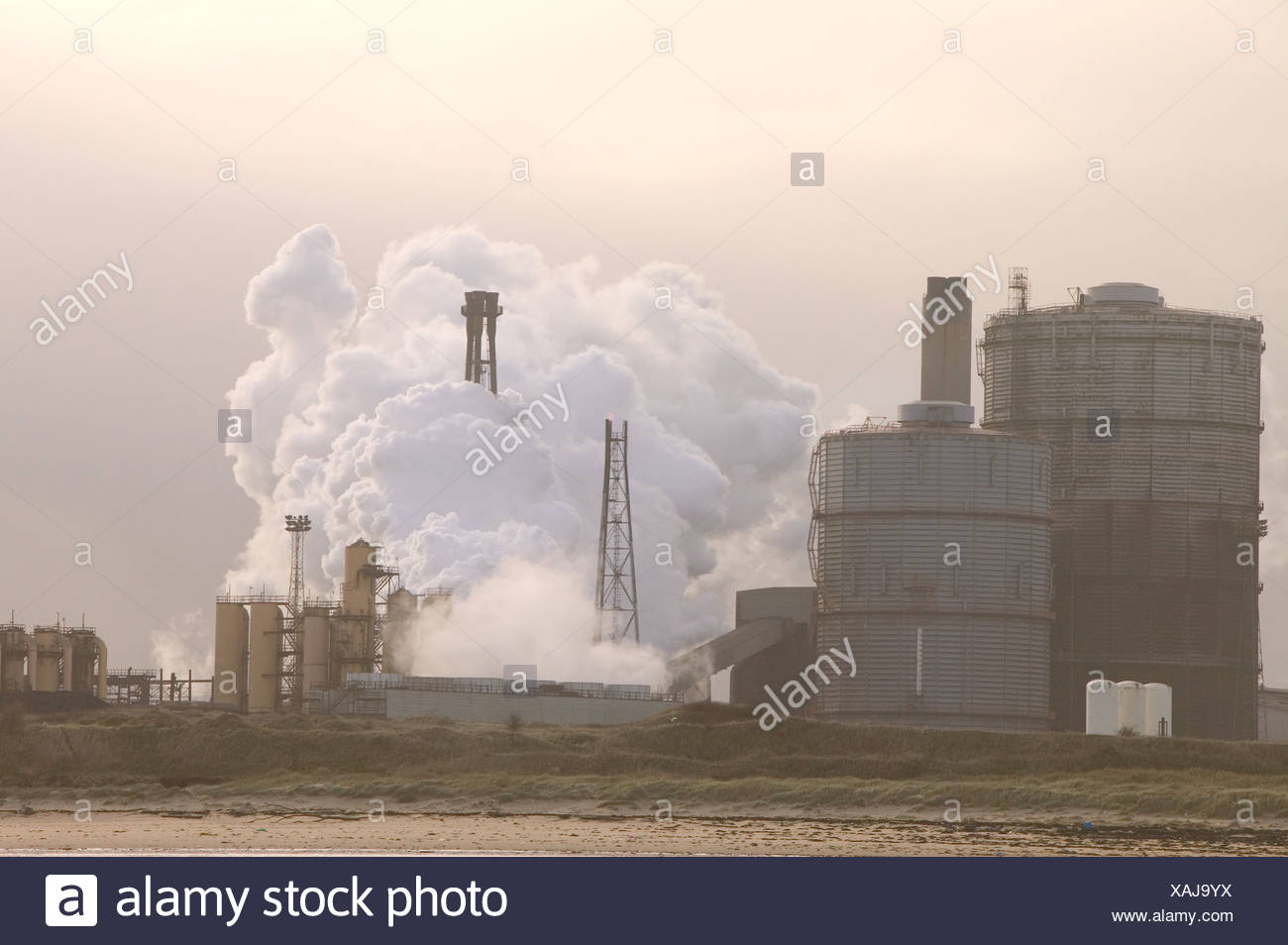 The corus steelworks at Redcar, Teeside, releasing clouds of steam and pollution - Stock Image