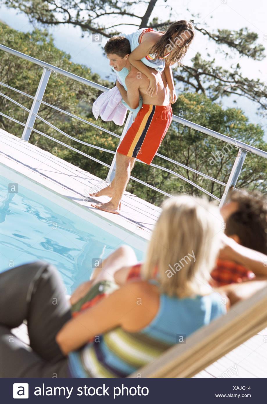 Mature women and men at pool beach