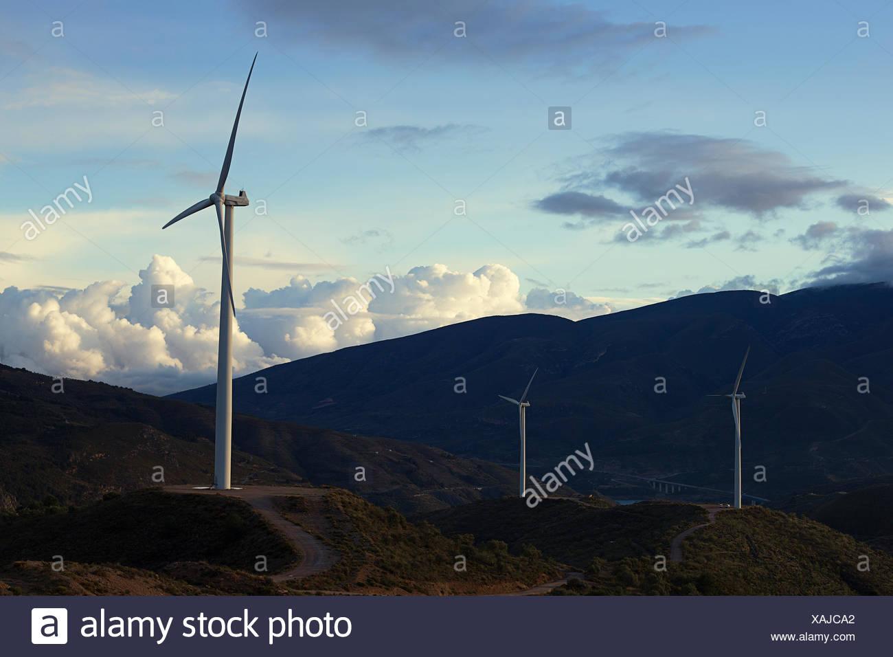 Three wind turbines in rural landscape, Spain - Stock Image