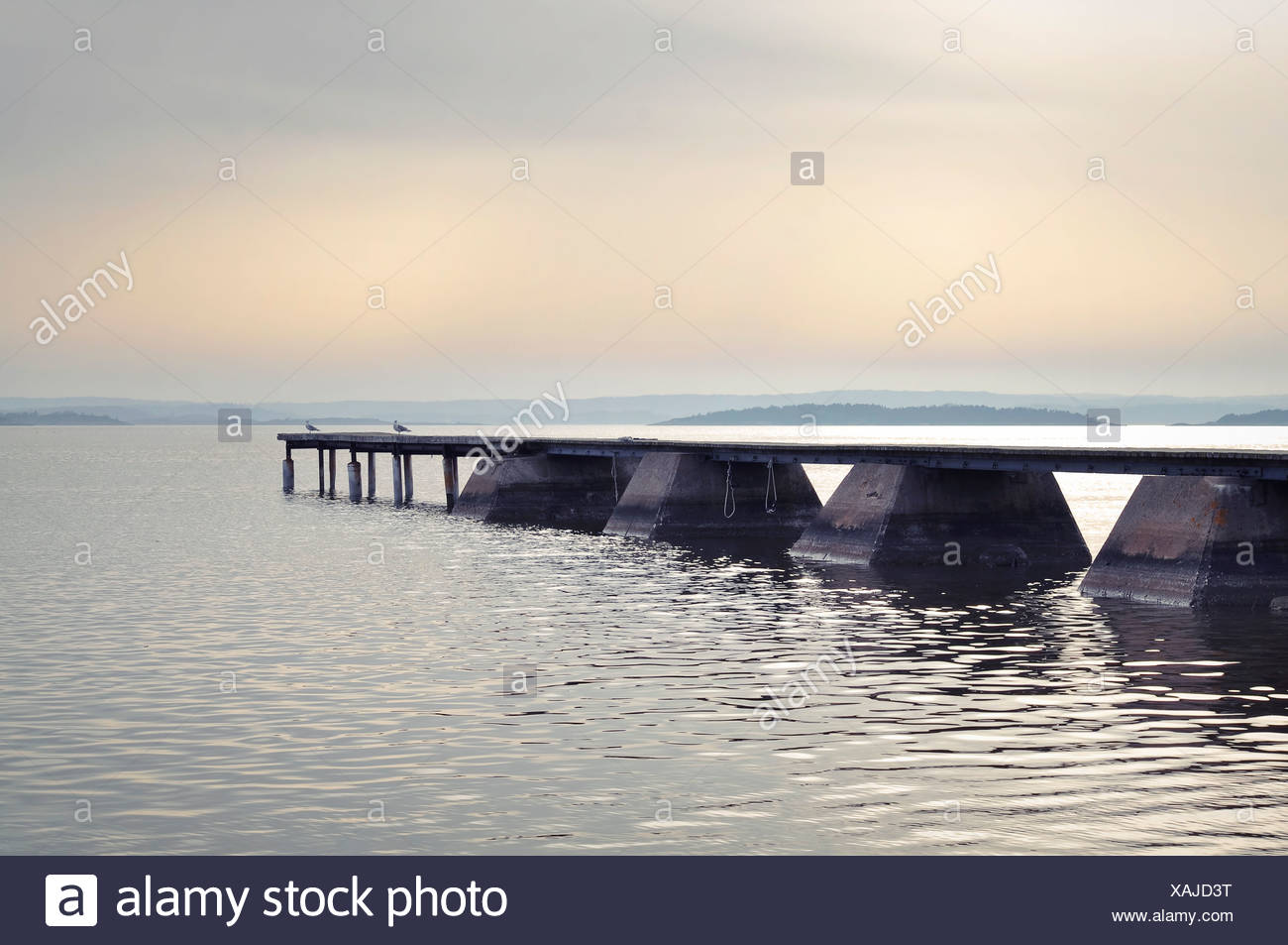 Idyllic view of jetty in lake - Stock Image