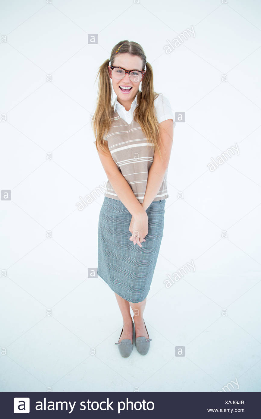Smiling geeky hipster smiling at camera - Stock Image