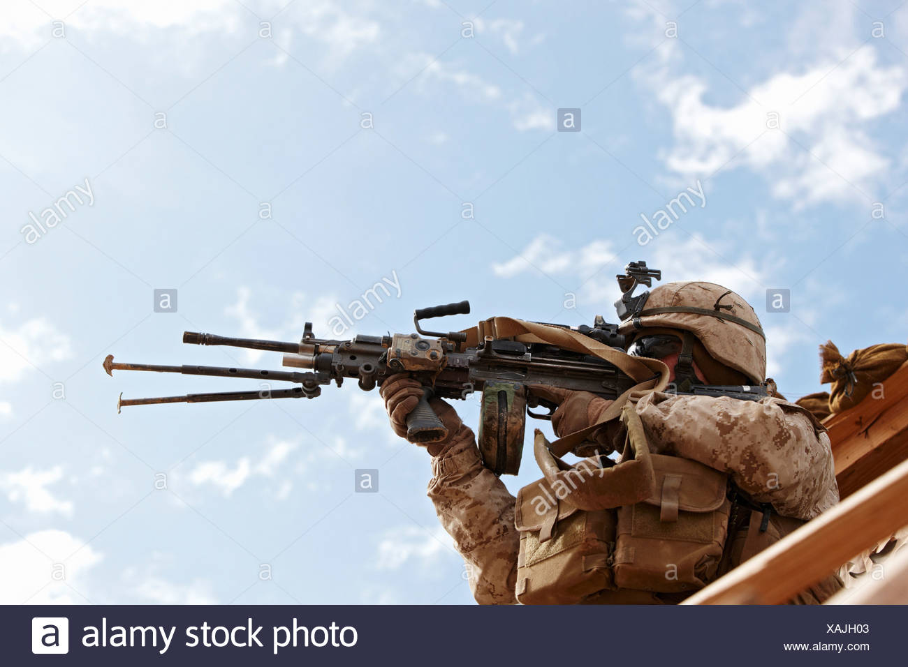 U.S. Marine Aims M249 Squad Automatic Weapon or SAW Helmand Province Afghanistan. - Stock Image