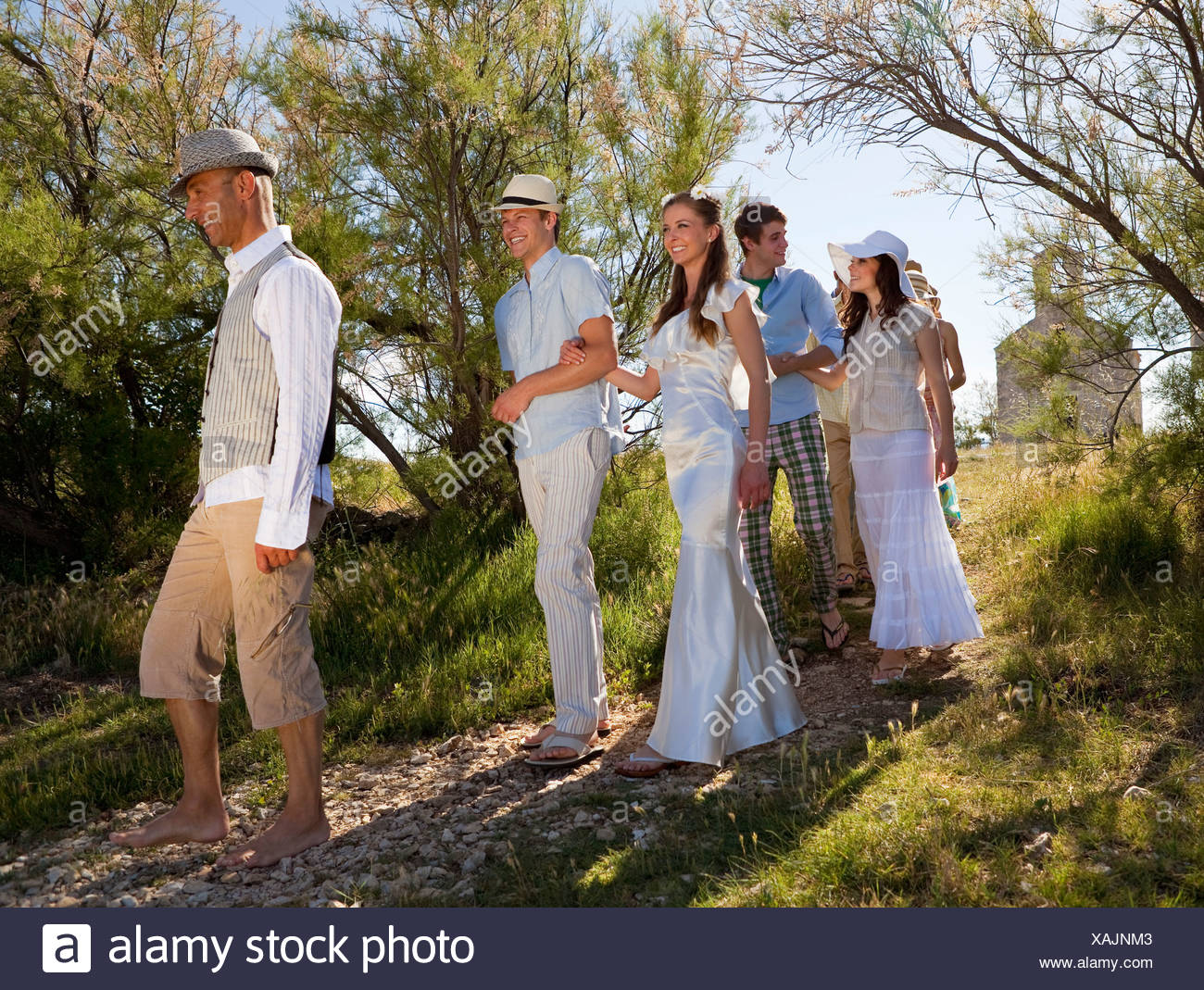 Bridal procession walking on rural path - Stock Image