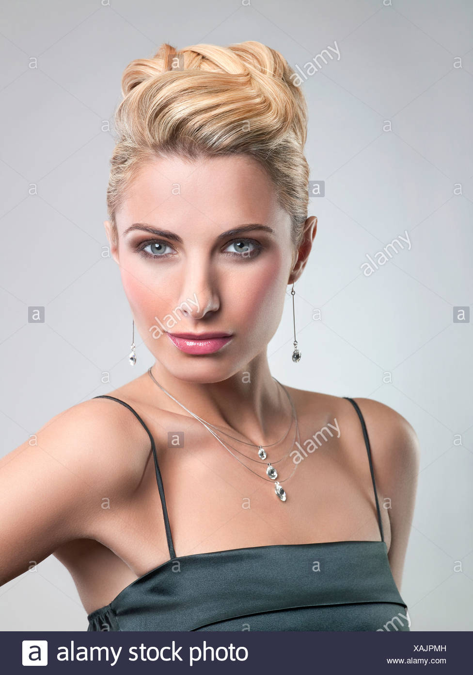Young woman in formalwear looking at camera - Stock Image