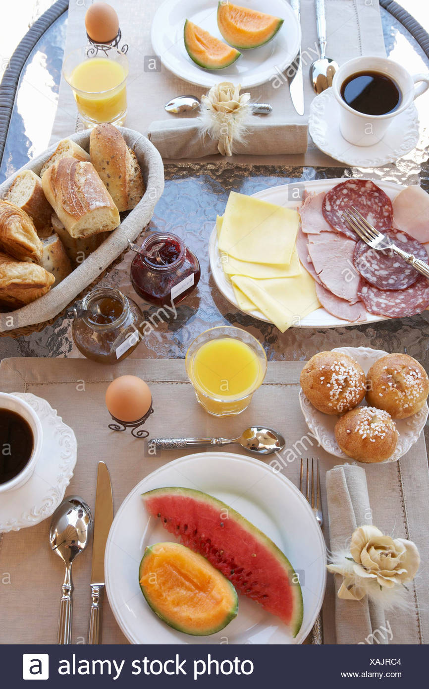 Table laid with breakfast - Stock Image