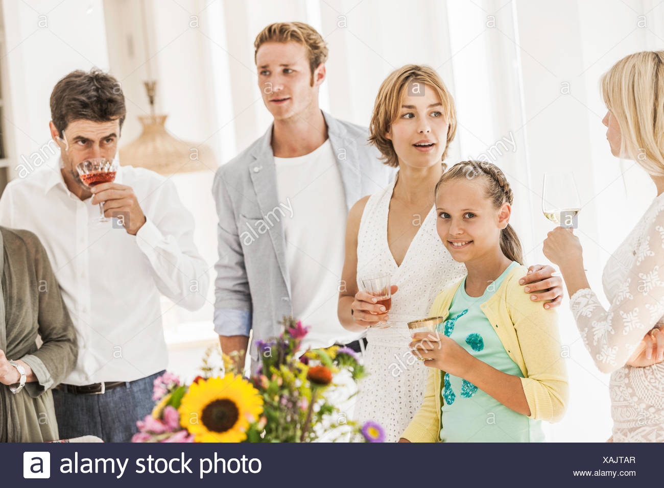 Family drinking wine at birthday party - Stock Image