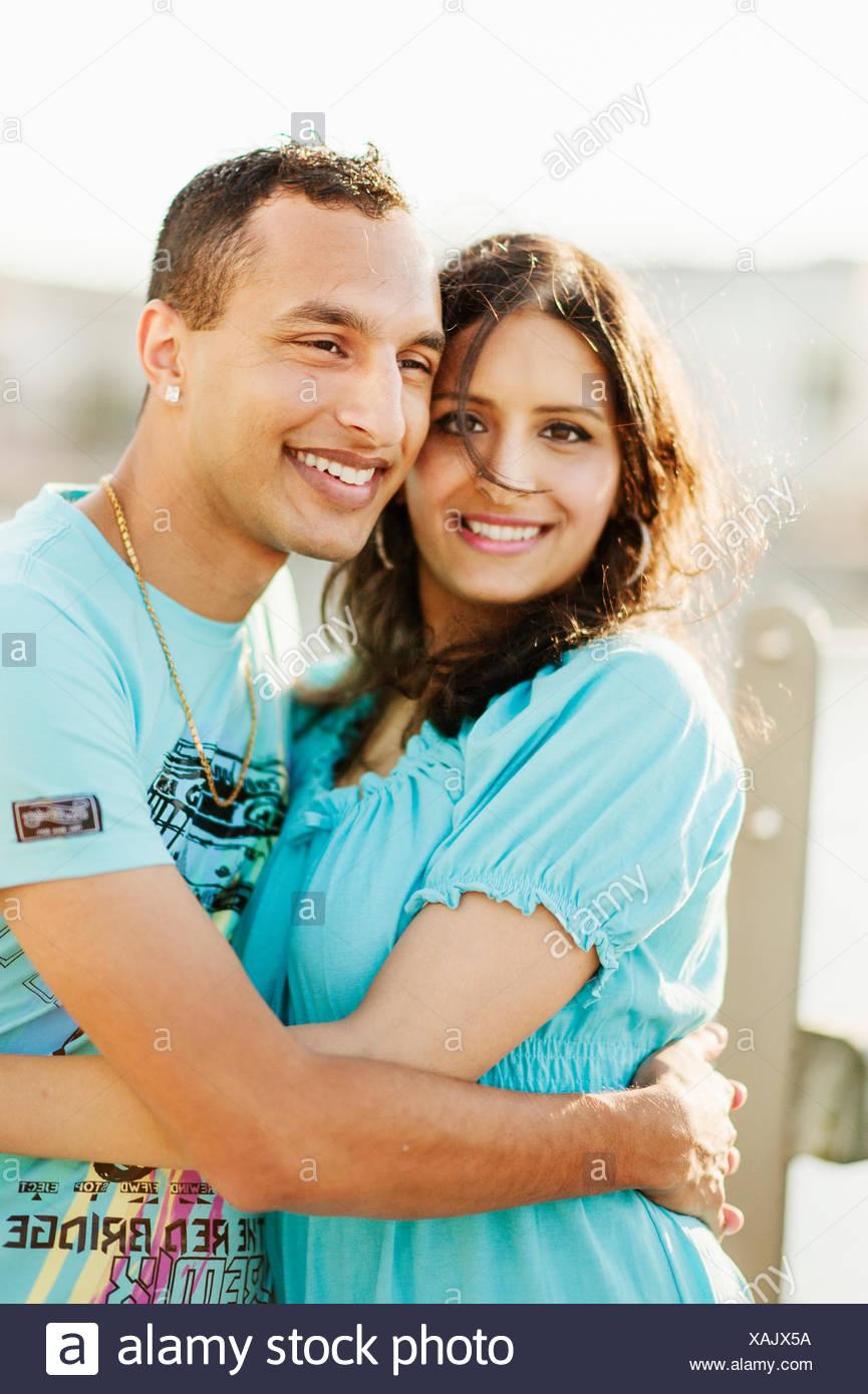 Sweden, Vastra Gotaland, Gothenburg, Young couple embracing - Stock Image