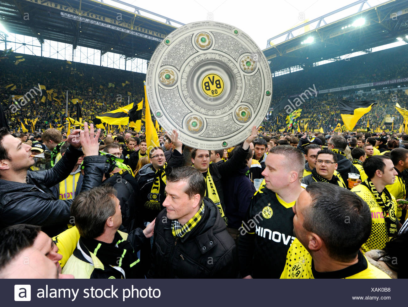 Football club BVB Borussia Dortmund fans on the pitch with a dummy of the league cup trophy, after match Borussia Dortmund vs SC Stock Photo