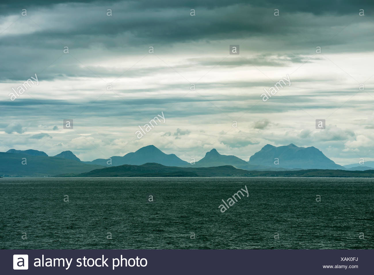 Bay Loch Ewe with the striking silhouette of the Northwest Highlands, Ross and Cromarty, Scotland, United Kingdom - Stock Image