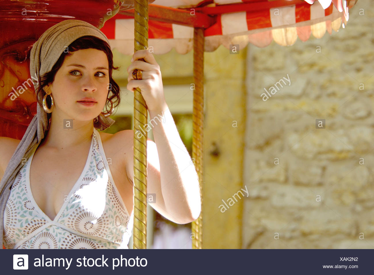 young women on a merry-go-round , Germany - Stock Image