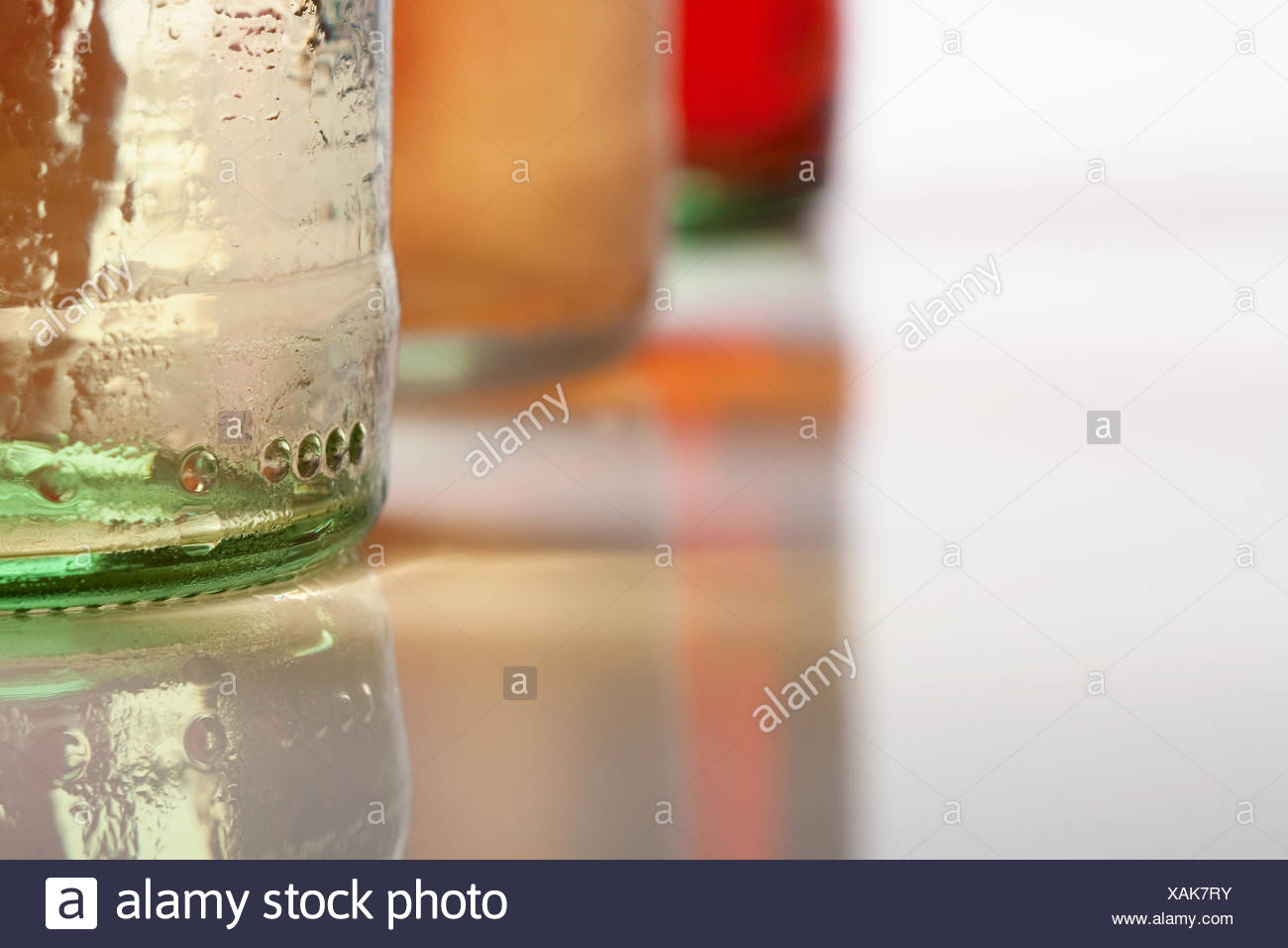 Three cool bottles of fresh beverages - Stock Image