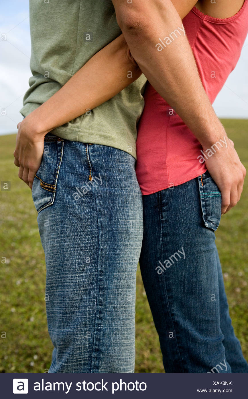 Two young lovers embracing - Stock Image