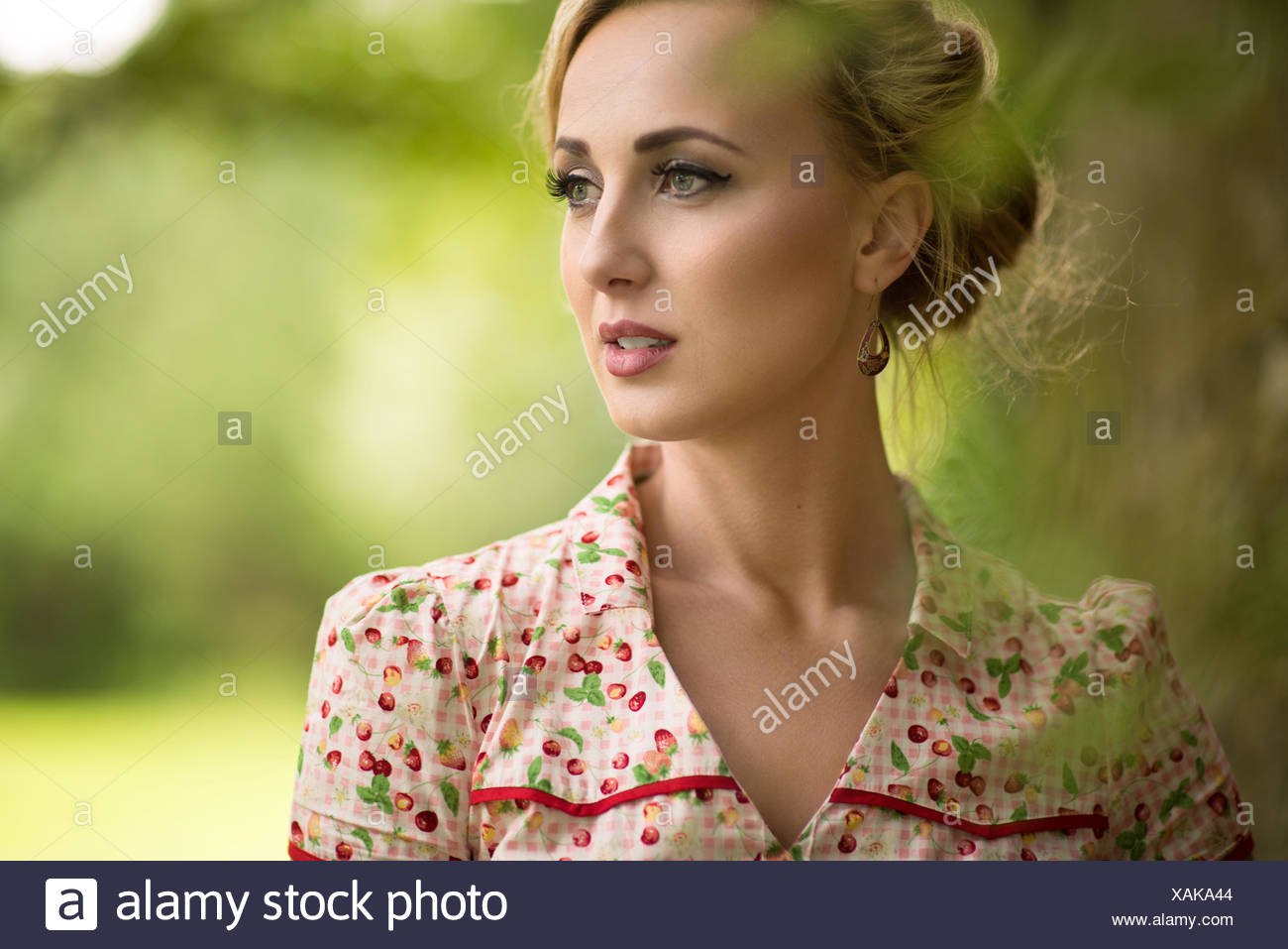 Portrait of a young woman looking away - Stock Image
