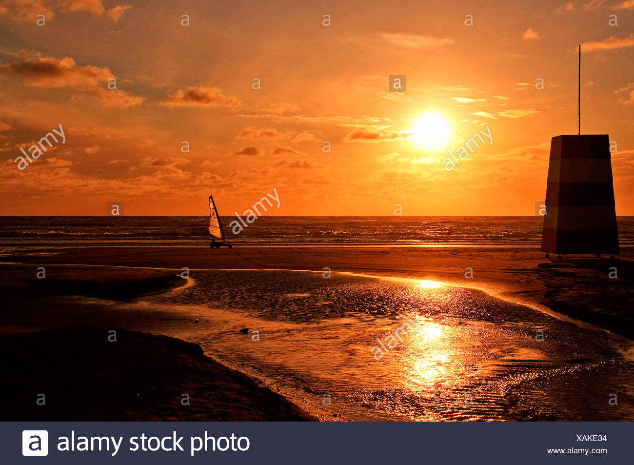 Beach, sunet, lifeguard tower and a beach boogie - Stock Image