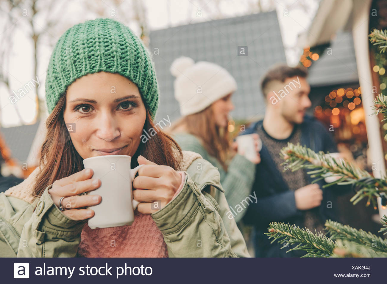 Woman having a hot punch on the Christmas Market - Stock Image