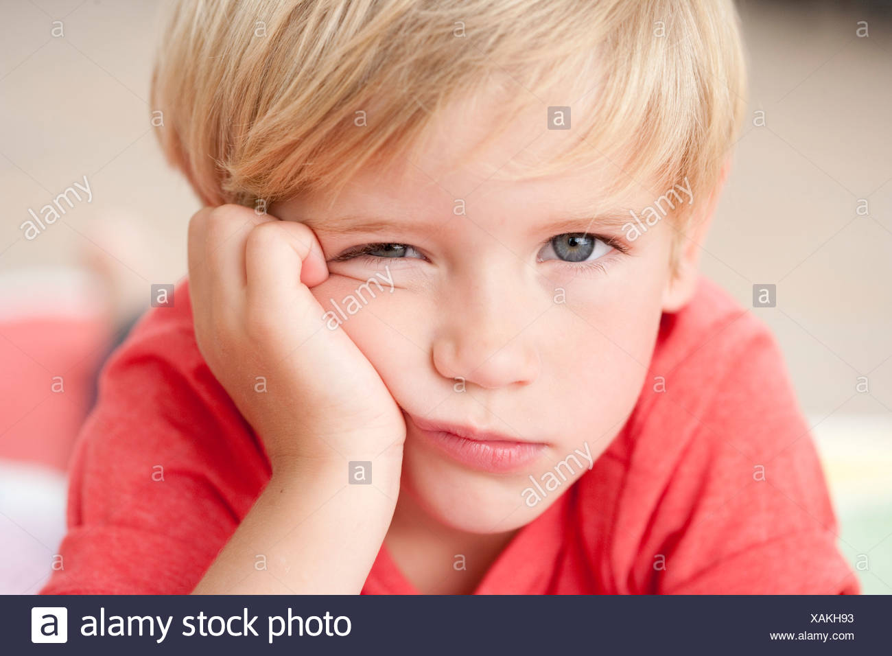 young boy looking bored at viewer Stock Photo