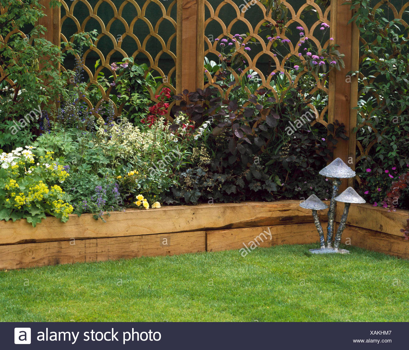 Raised Bed - backed with ornamental fence - (Please credit ... on raised garden deer fence, raised garden planner, raised garden decks, raised gardens designs, raised garden irrigation plans, raised garden benches, raised garden roofing, raised garden bins, raised garden water systems, raised garden edging, raised garden concrete, raised garden boards, raised garden timbers, raised garden planting, raised garden drainage, raised garden building, raised garden dog fence, raised garden kits, raised garden gates,