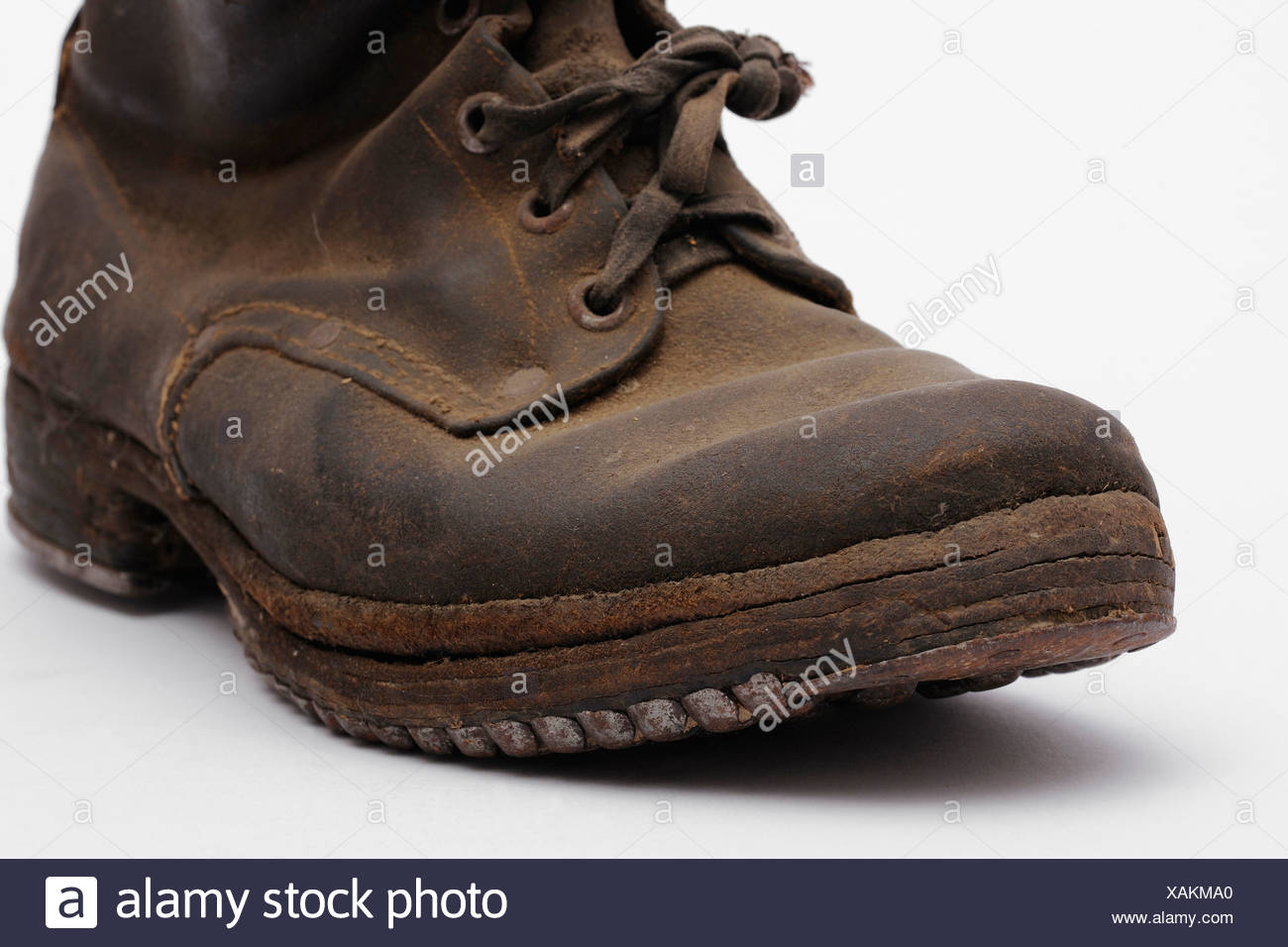 Old mountain boots with nailed soles and iron heels - Stock Image