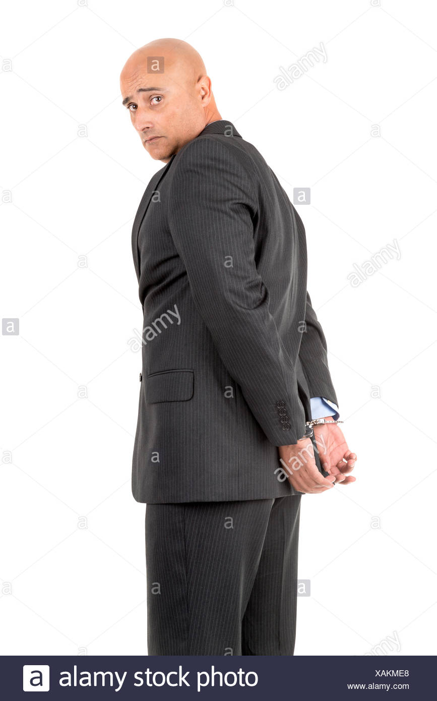 Businessman in handcuffs - Stock Image