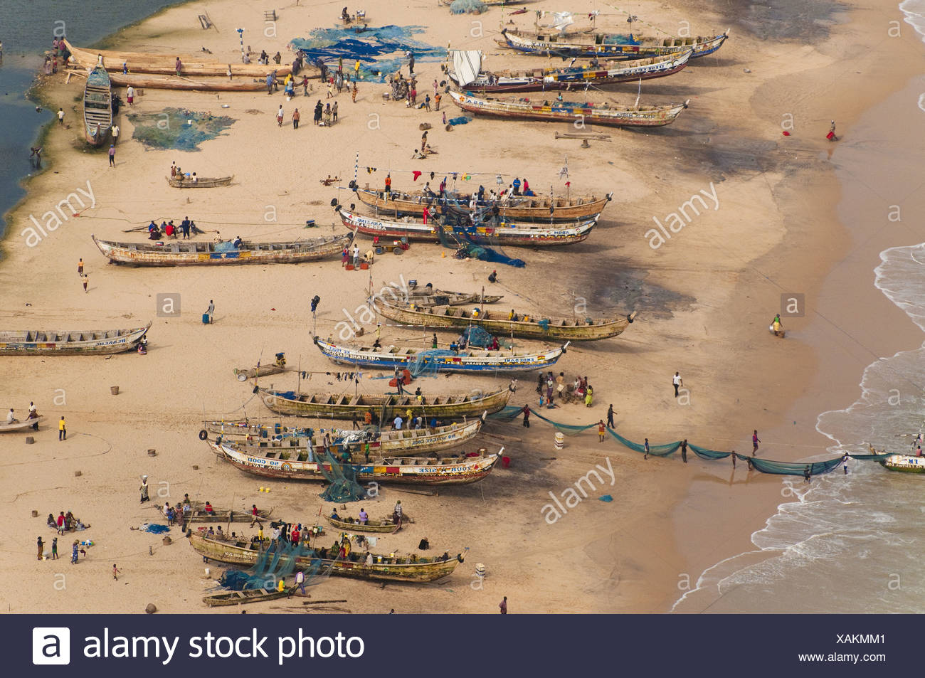 Seagoing fishing canoes hauled out on beach Ghana Ghana - Stock Image