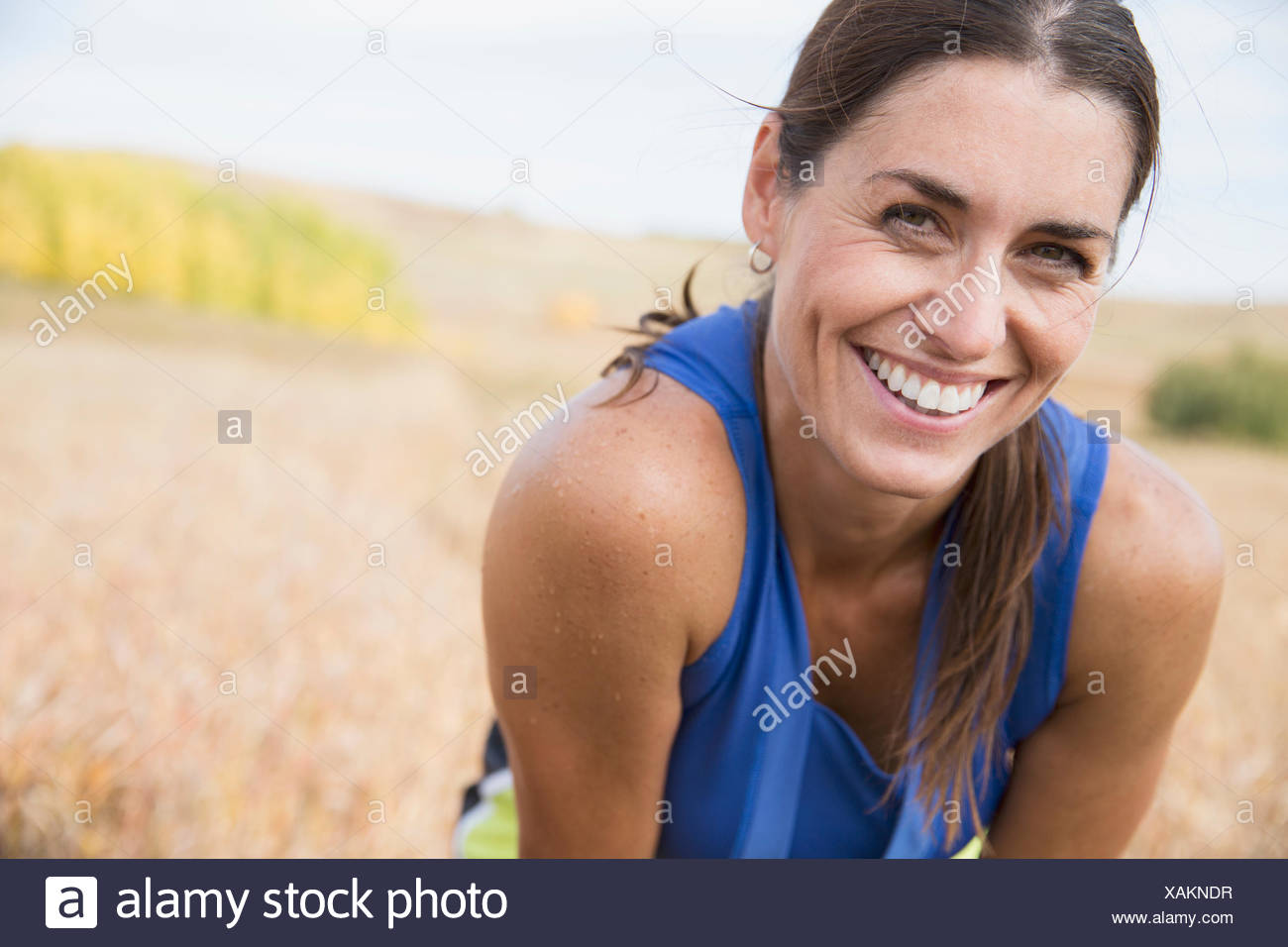 Pretty woman smiling after outdoor run. - Stock Image