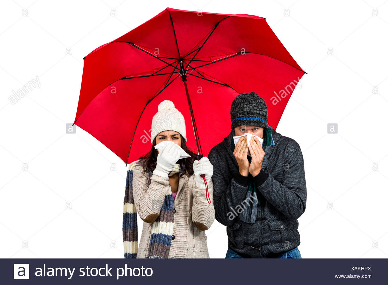 Sick couple blowing their noses - Stock Image