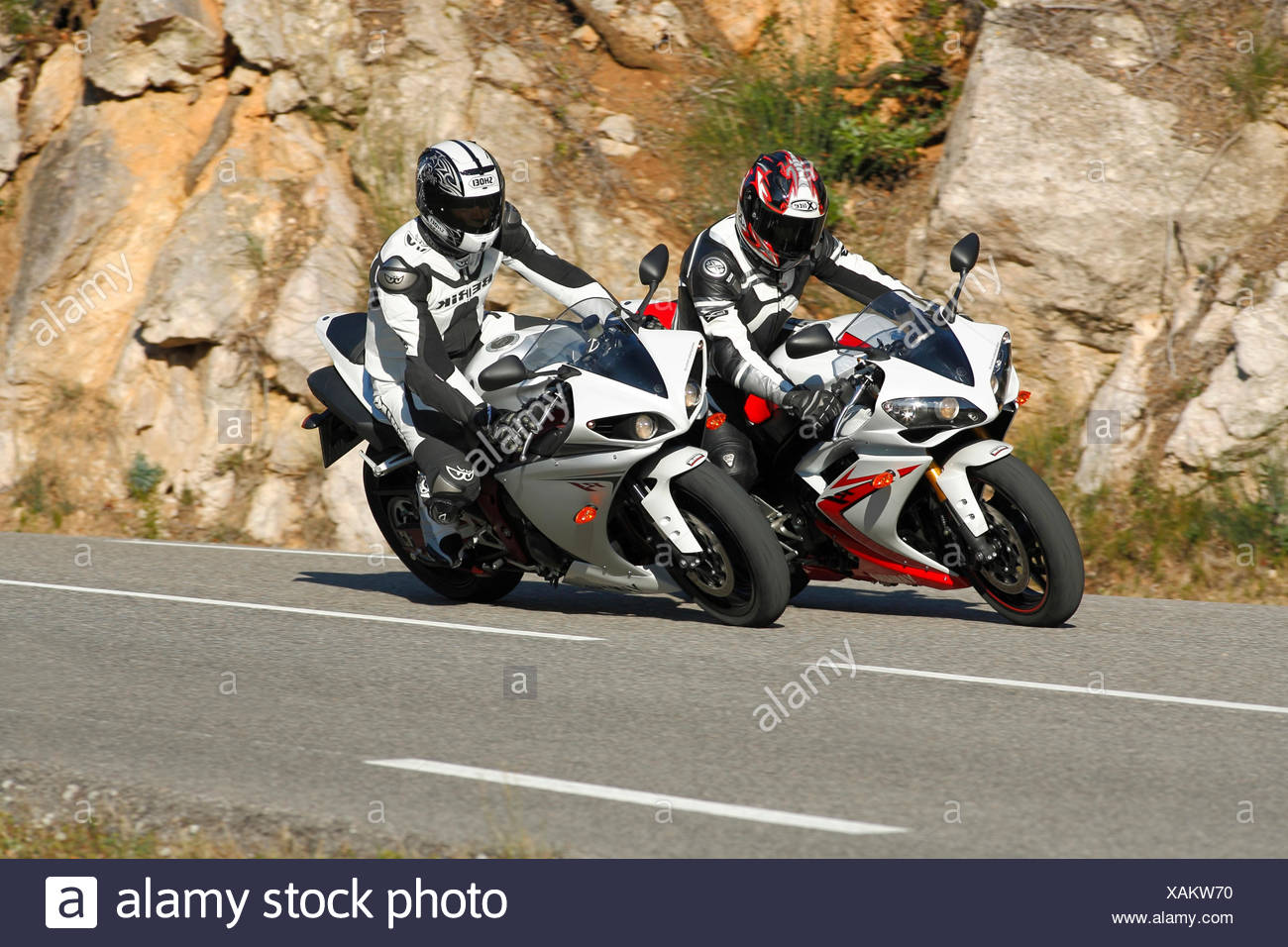 Two Yamaha YZF R1 motorcycles - Stock Image