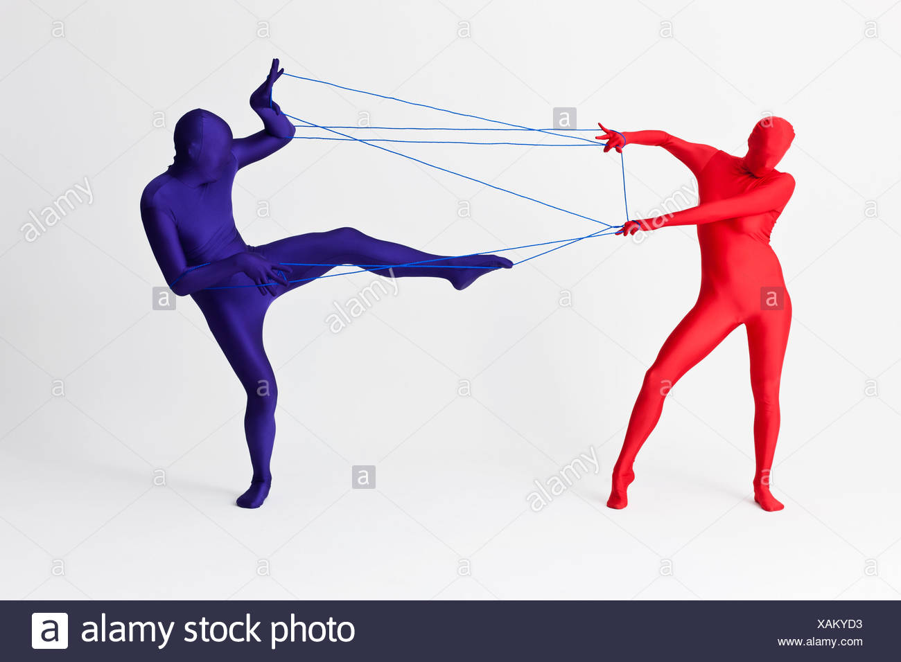 Couple in bodysuits playing with string - Stock Image