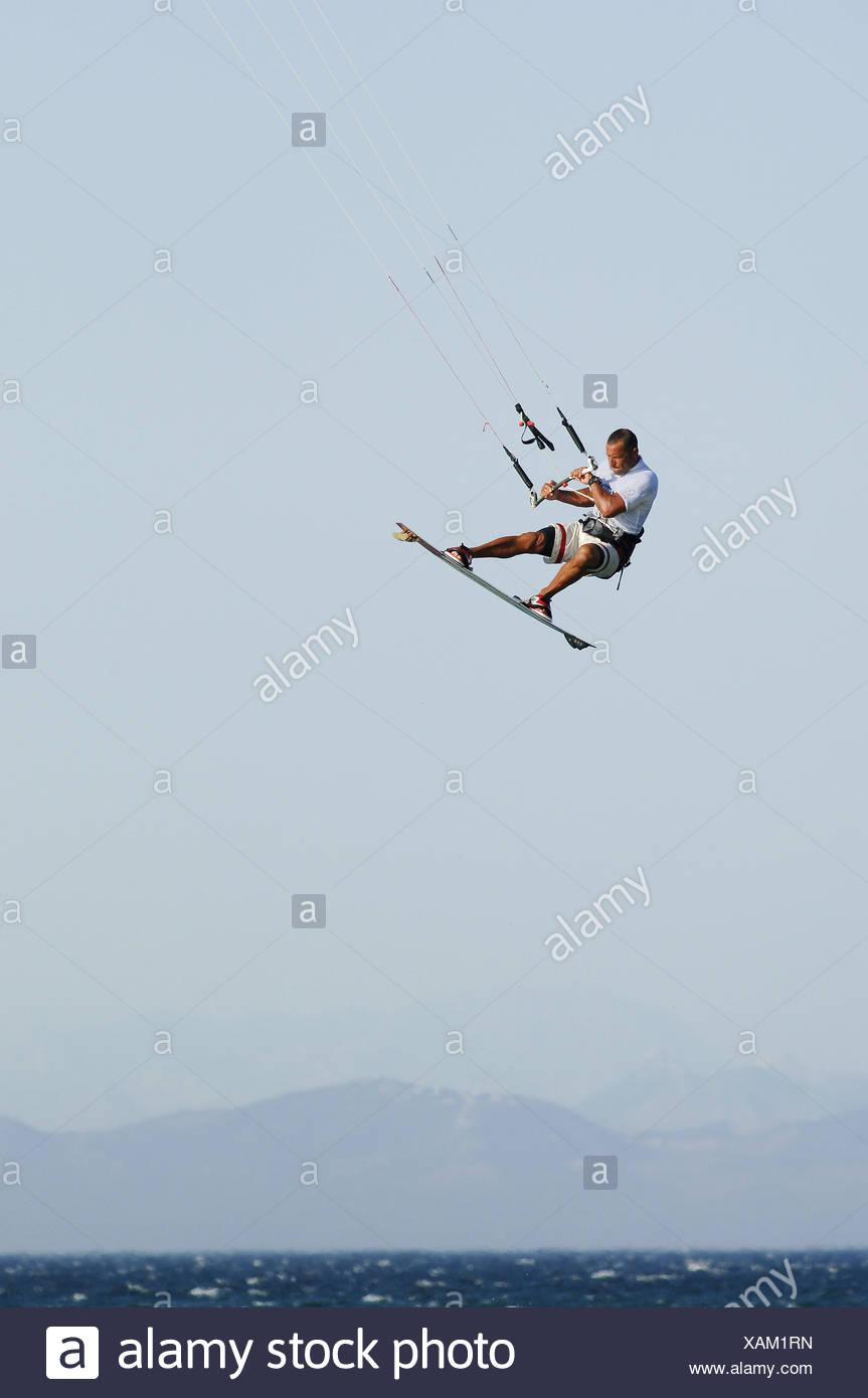 kite surfer flying in tarifa - Stock Image