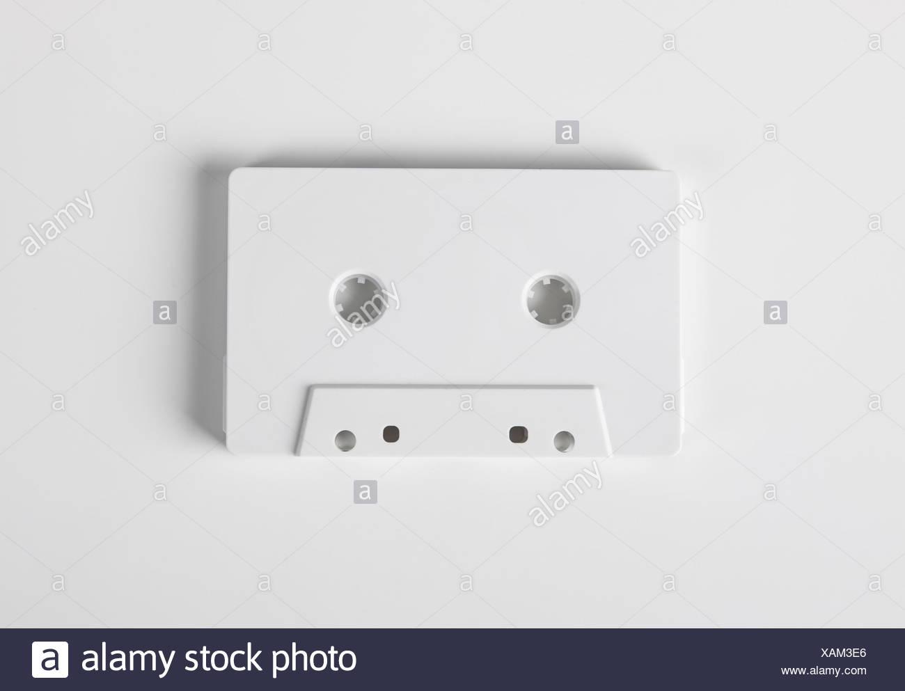 Blank audio cassette on white background - Stock Image
