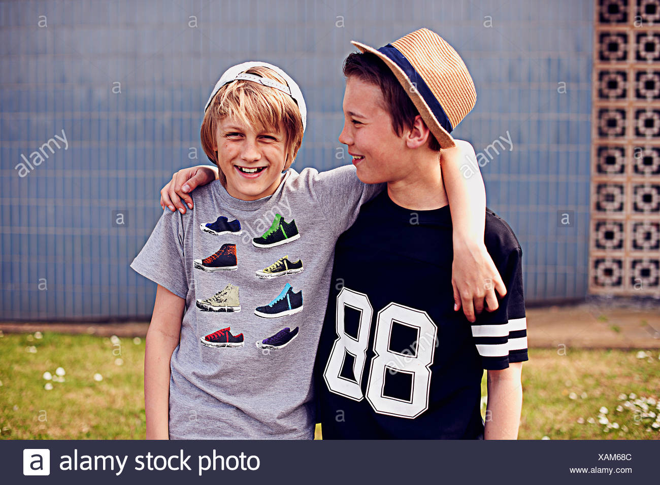 Two boys with arms around each other, portrait - Stock Image
