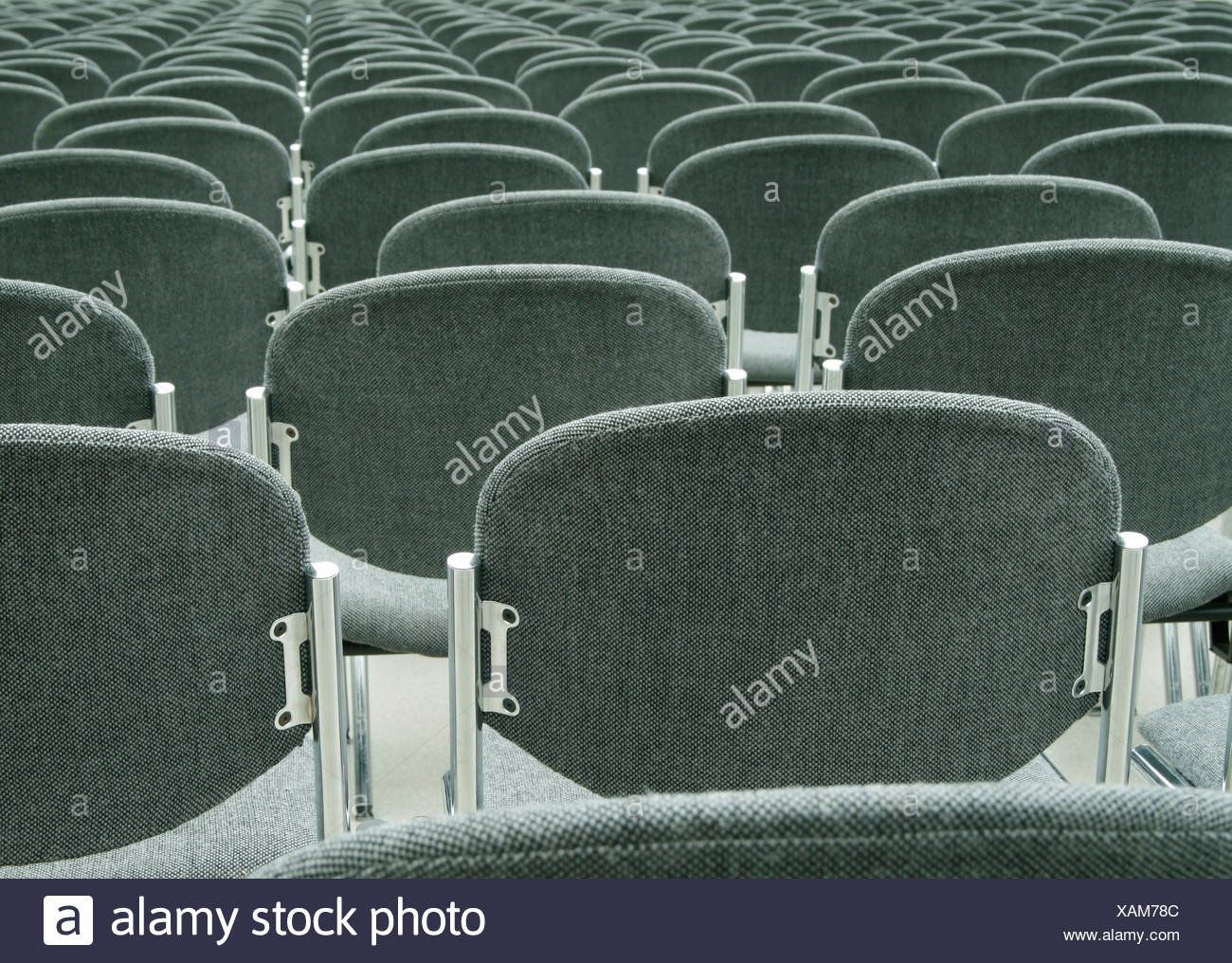 Rows of empty chairs in conference room Stock Photo
