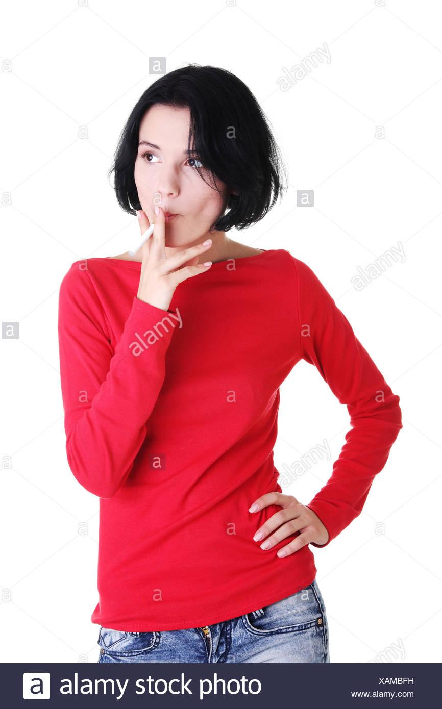 Young woman smoking electronic cigarette -ecigarette - Stock Image