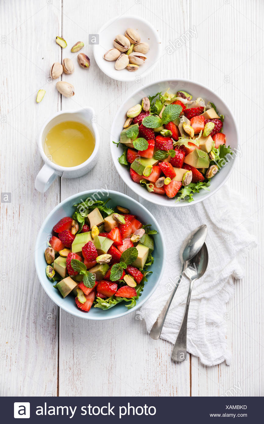 Lettuce salad with avocado and strawberry - Stock Image