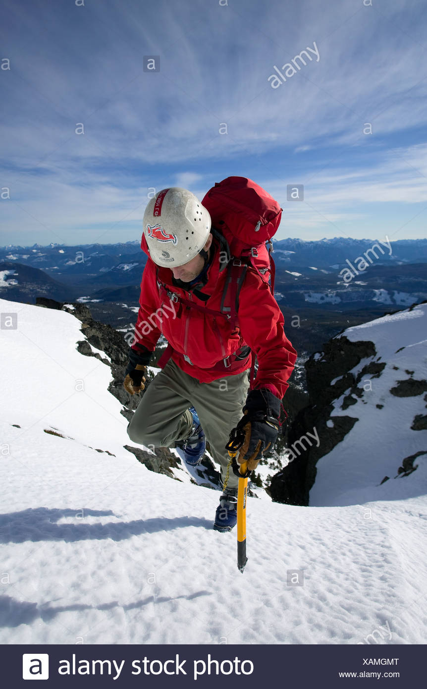 A climber ascends the final snowfield leading to the summit of Mt. Cain on Central Vancouver Island. Stock Photo