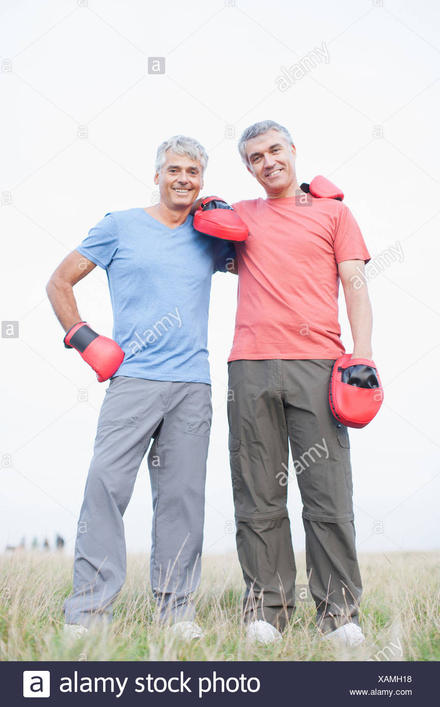 Boxer standing with his sparring partner - Stock Image