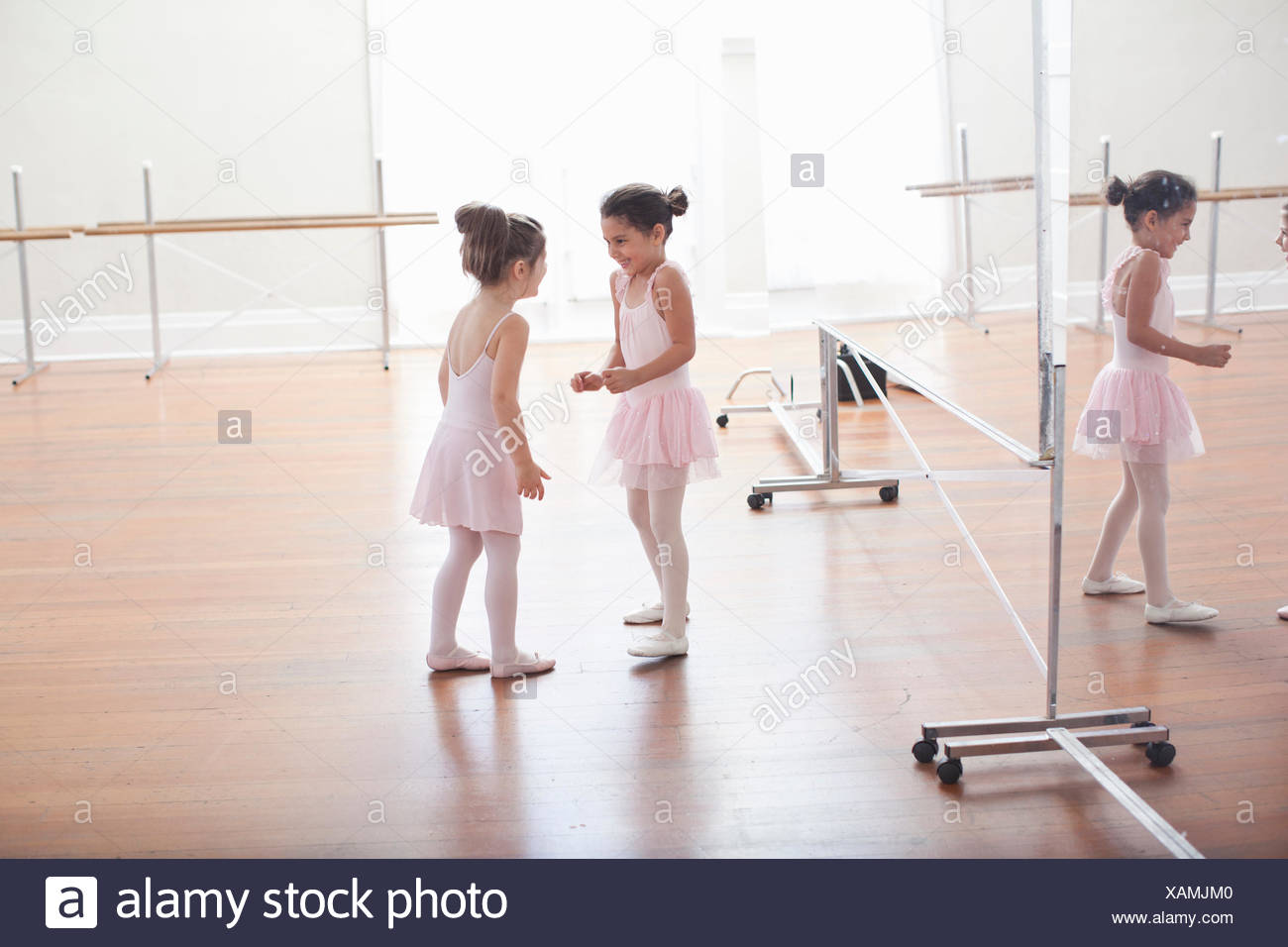 Two child ballerinas chatting in ballet school - Stock Image